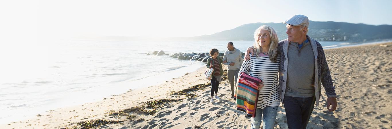 Senior couple walking on a beach