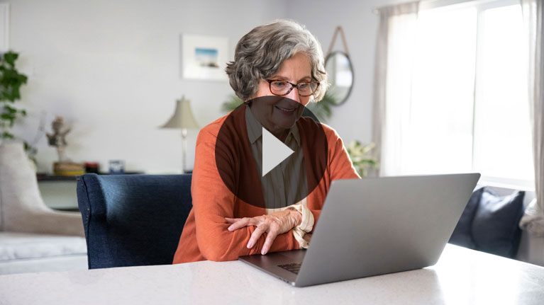Elderly lady checking engaging with an online telehealth doctor on her laptop.