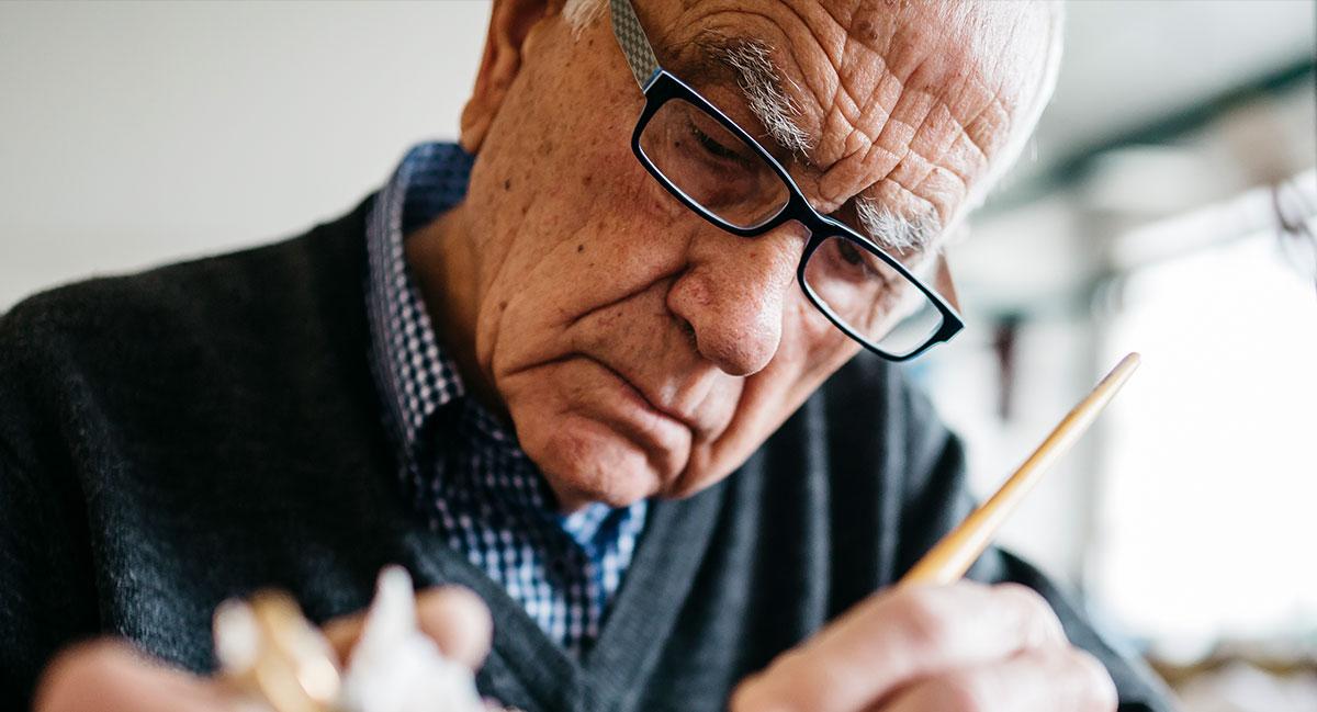 Elderly man painting