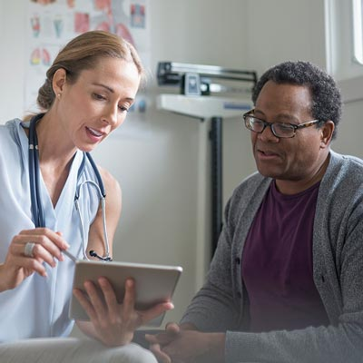 Female doctor in clinic, advising patient on test results
