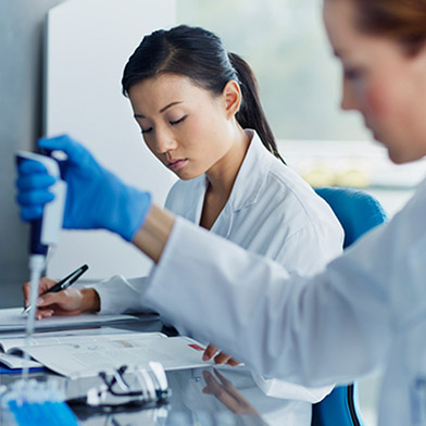 Two female pharmaceutical scientists working in a lab