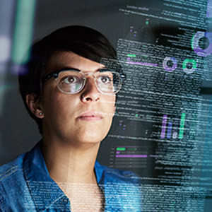 Female IT specialist scanning code on a virtual screen