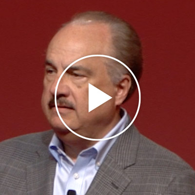 Portrait photo of Larry Merlo speaking at the 2018 CVS Health Forum